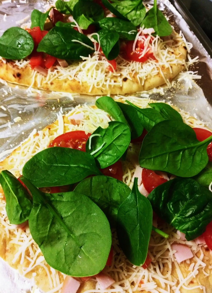 Naan pizza with fresh spinach