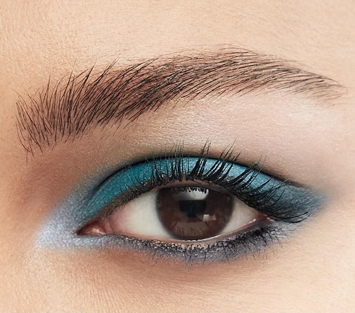 Model wearing Tranquility Blue Matte Eyeshadow Quad from Avon