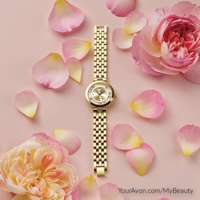 Floating Stones Watch by Avon with Swarovski stones and genuine mother of pearl.