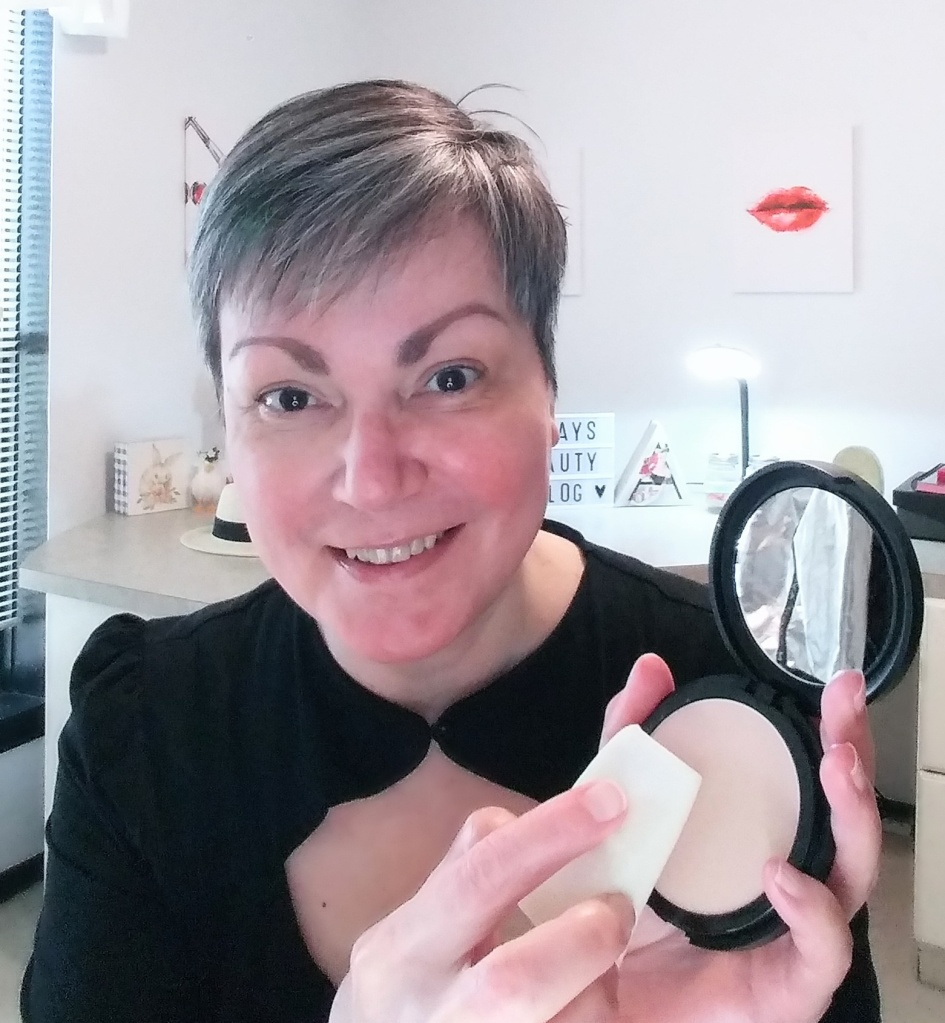 Applying Avon's Cashmere Complexion Compact Powder Foundation.
