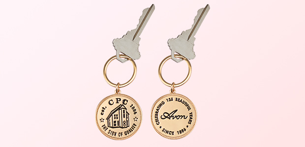 Avon commemorative keychain celebrating 135 years of beauty.
