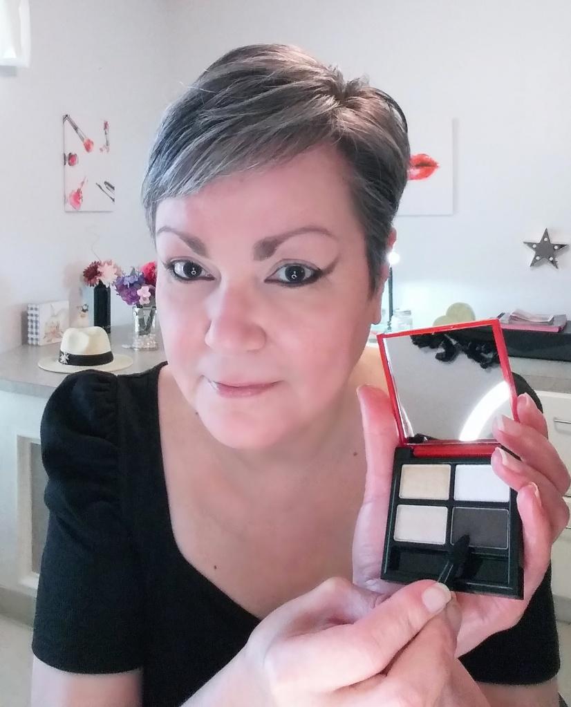 Applying the new Glimmer Eyeshadow Quad in Goddess from Avon.
