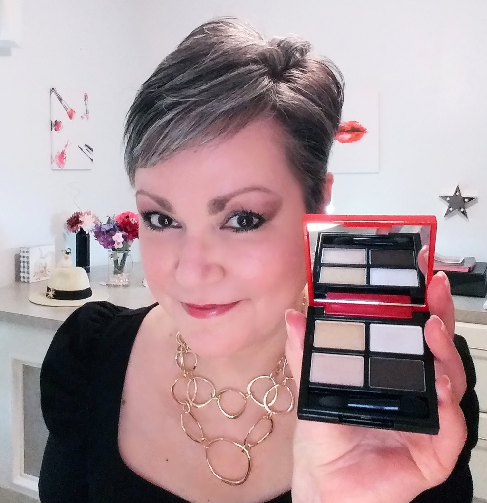 Shimmery gold and silver eyeshadows plus dark brown in the Goddess Eyeshadow Palette from Avon.