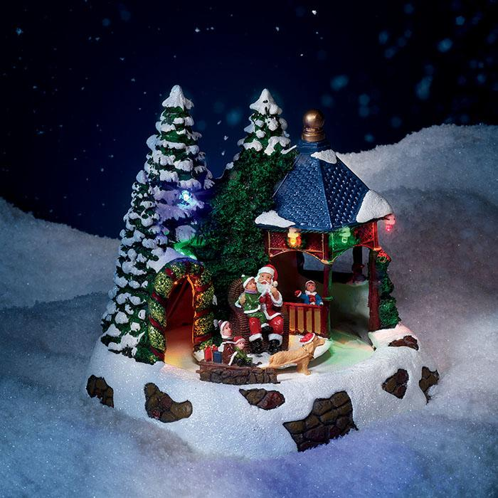 Holiday Light Up Scene with Santa. Plays 8 Christmas songs.